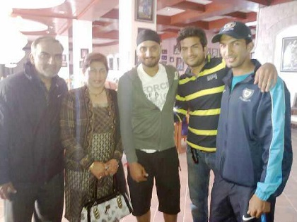 Rishi Dhawan with parents and friends
