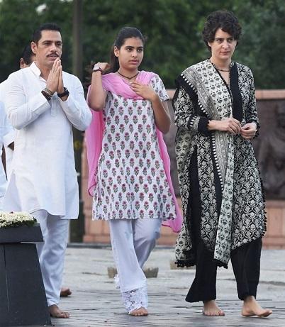 RPT:New Delhi:Priyanka Vadra with her husband Robert Vadra and daughter Miraya Vadra after paying tribute to former Prime Minister Rajiv Gandhi on his 71st birth anniversary at Vir Bhumi in New Delhi on Thursday. PTI Photo by Manvender Vashist(PTI8_20_2015_000008B)